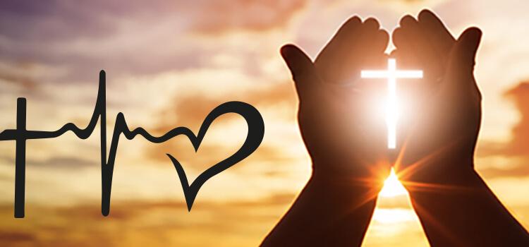 Set of hands held in front of sun with cross glowing betweehn them