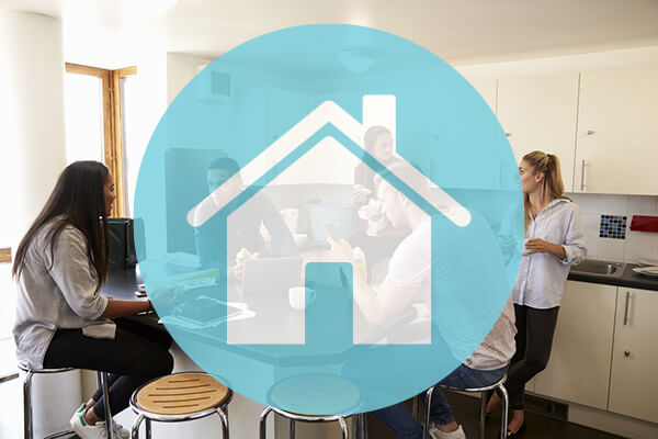 people sitting in kitchen talking with icon of blue house covering picture